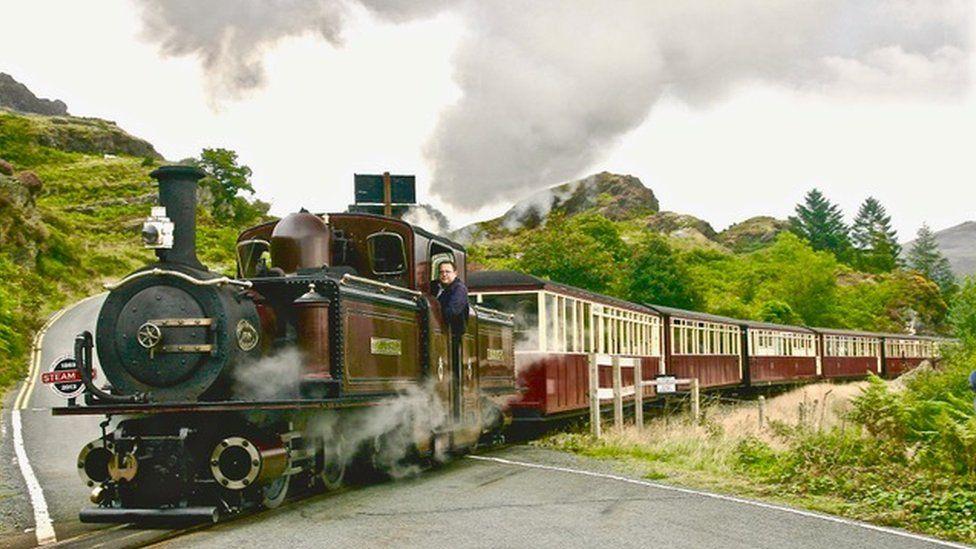 Ffestiniog and Welsh Highland Railways locomotive near Tanygrisiau crossing a road