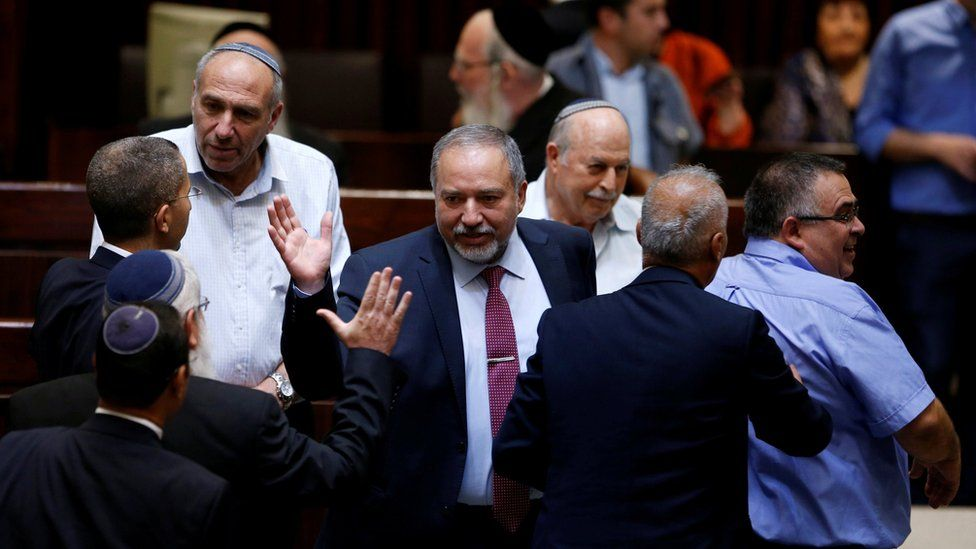 Avigdor Lieberman is greeted in the Knesset, Israel's parliament, in Jerusalem on 23 May 2016