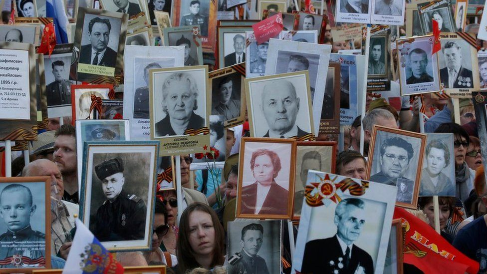 People hold pictures of World War Two soldiers as they take part in the Immortal Regiment march during the Victory Day celebrations, marking the 71st anniversary of the victory over Nazi Germany in World War Two, in central Moscow, Russia, May 9, 2016