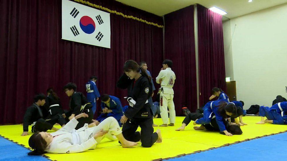 Image shows a university jiu-jitsu class