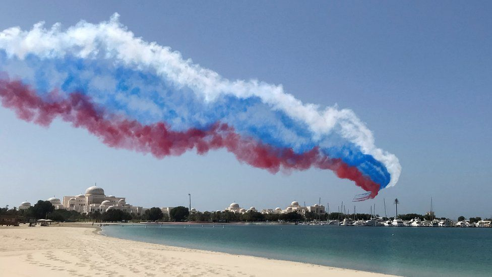 Aircraft blaze a trail in the colours of the Russian flag during Mr Putin's visit to Abu Dhabi on 15 October