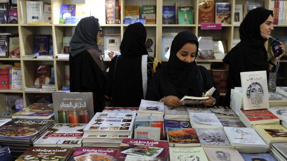 Women attend the Jeddah International Book Fair on December 17, 2016 in the Saudi Red Sea port city of Jeddah