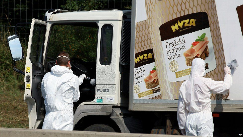 Investigators search a truck on the A4 motorway in Austria that was found with several dead people on board - 27 August 2015