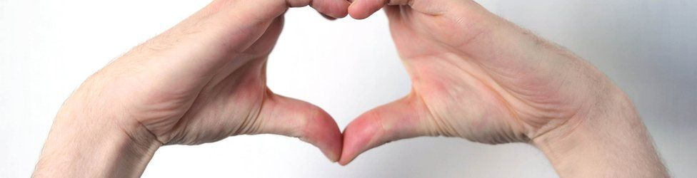 File photo dated 22/06/15 of a general view of a male hand gesturing in heart shape