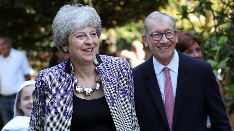 Theresa May and her husband Philip leaving a local church