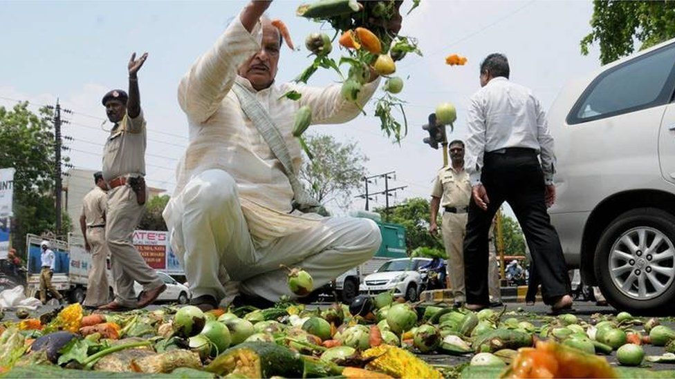 Farmers throwing vegetables on a road during a protest as part of the Maharashtra bandh over various demands in Nagpur, Maharashtra