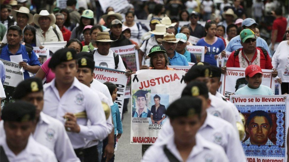 People take part during a march organized by parents and relatives of the 43 missing students of Ayotzinapa College Raul Isidro Burgos in Iguala