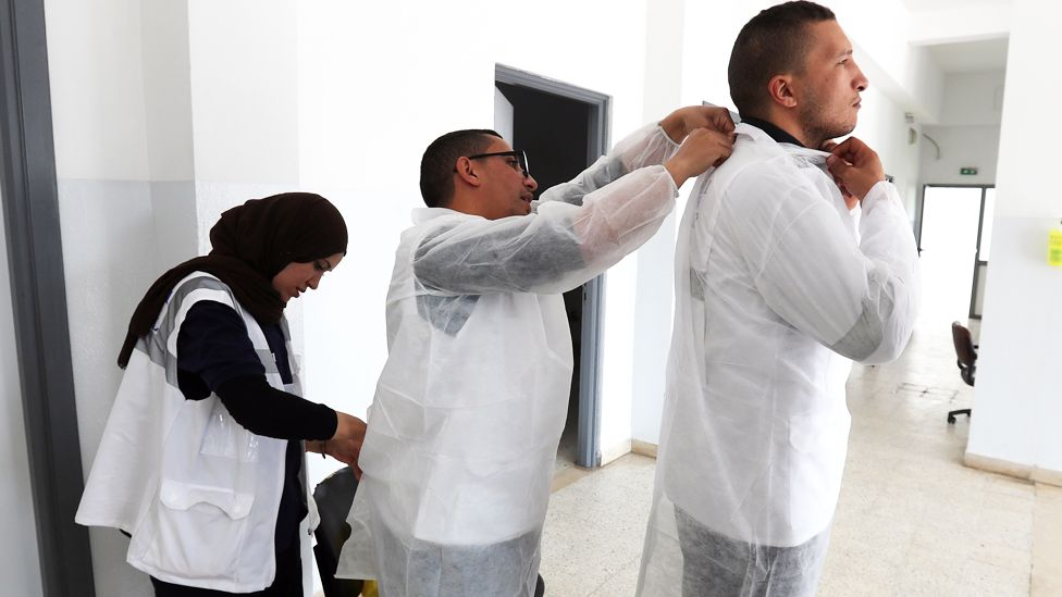 Medics putting on protective gear in Tunis, Tunisia - Tuesday 7 April 2020