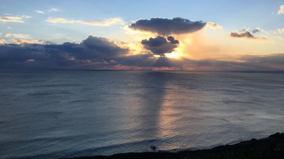 The sun sets over the sea