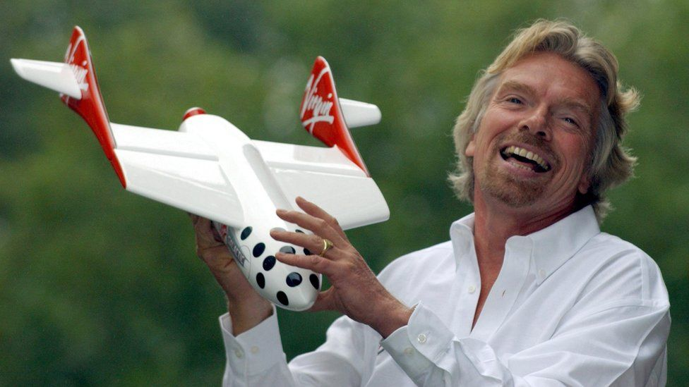 Sir Richard poses with a model of the Virgin spaceship in 2004, after announcing his intention to offer space flights to paying passengers