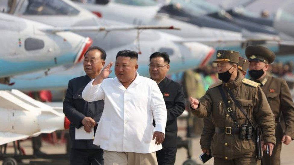 Kim Jong-un (centre) inspects North Korea's Air Force units on 12 April 2020