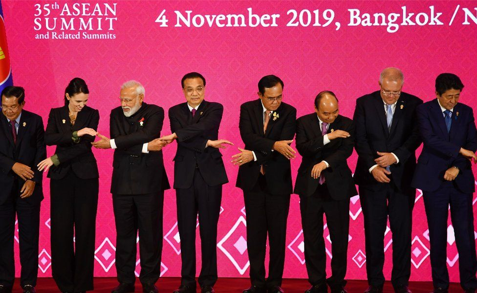 (From L to R) Cambodia's Prime Minister Hun Sen, New Zealand's Prime Minister Jacinda Ardern, India's Prime Minister Narendra Modi, China's Premier Li Keqiang, Thailand's Prime Minister Prayut Chan-O-Cha, Vietnam's Prime Minister Nguyen Xuan Phuc, Australia's Prime Minister Scott Morrison and Japan's Prime Minister Shinzo Abe prepare to pose for a group photo during the 3rd Regional Comprehensive Economic Partnership (RCEP) Summit in Bangkok in November 2019