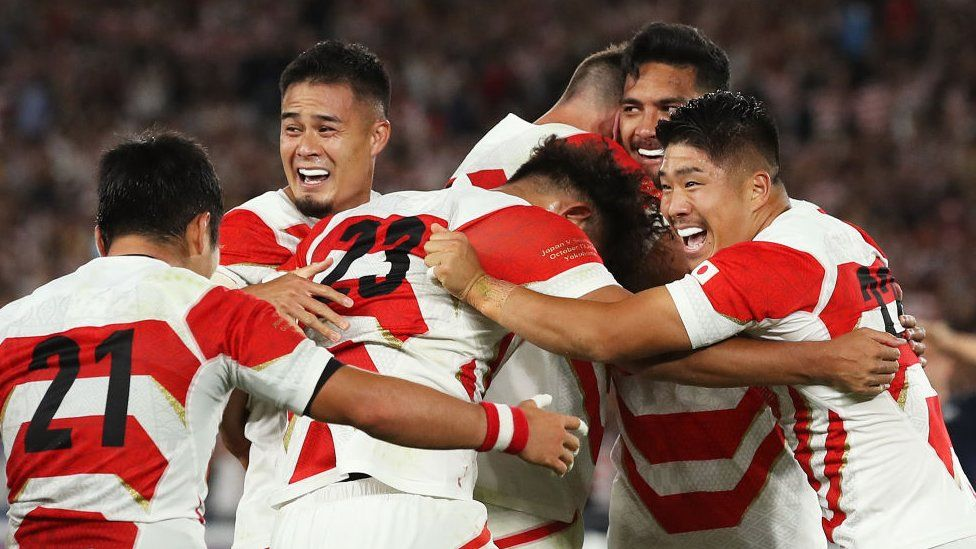 Japan players celebrate victory after the Rugby World Cup 2019