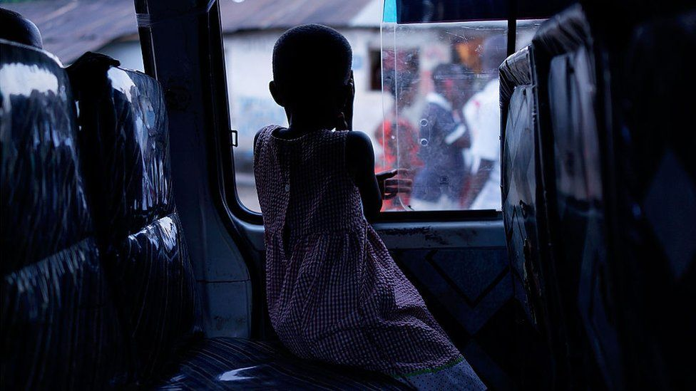A girl waits in a van as her family packs-up to leave the capital as tension increases before parliamentary elections on Monday on June 27, 2015 in Bujumbura, Burundi