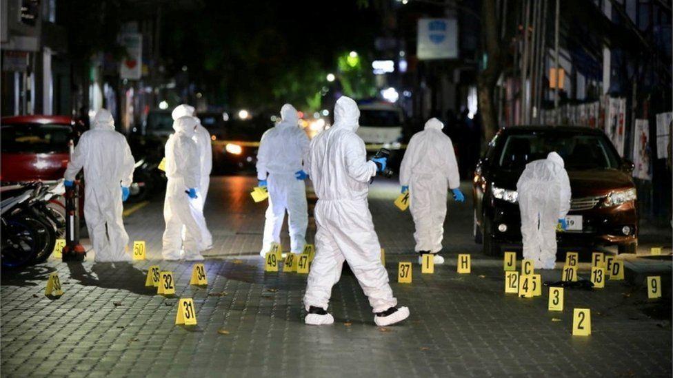 Police investigate the scene of the blast