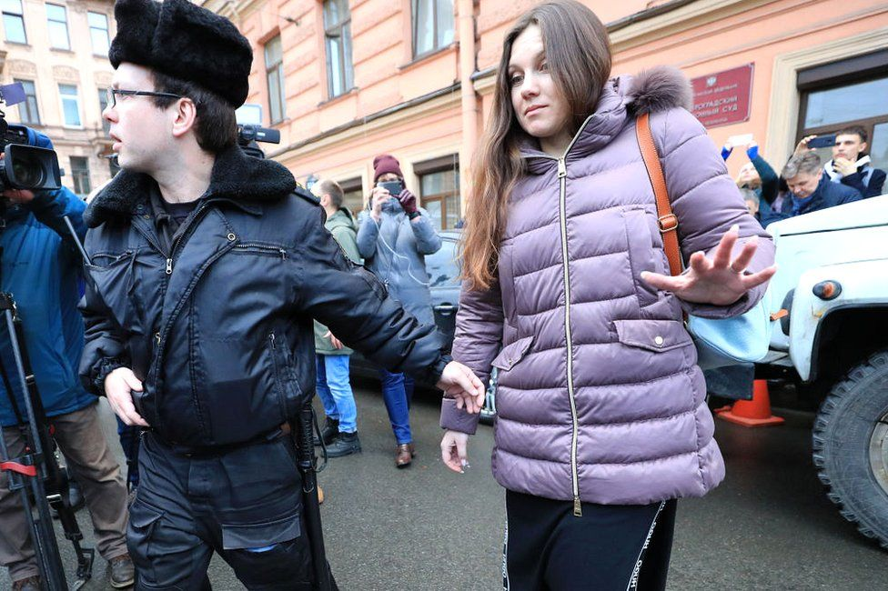 Alla Ilyina (R), who fled the quarantine area at Botkin Infectious Diseases Hospital upon her return from China, after a hearing at the Petrogradsky District Court