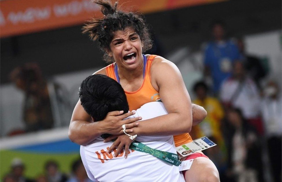 "India""s Sakshi Malik celebrates after winning against Kirghyzstan""s Aisuluu Tynybekova in their women""s 58kg freestyle bronze medal match on August 17, 2016, during the wrestling event of the Rio 2016 Olympic Games at the Carioca Arena 2 in Rio de Janeiro."