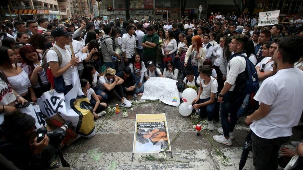 People gather in the street where Dilan Cruz was injured in Bogota, Colombia November 24, 2019