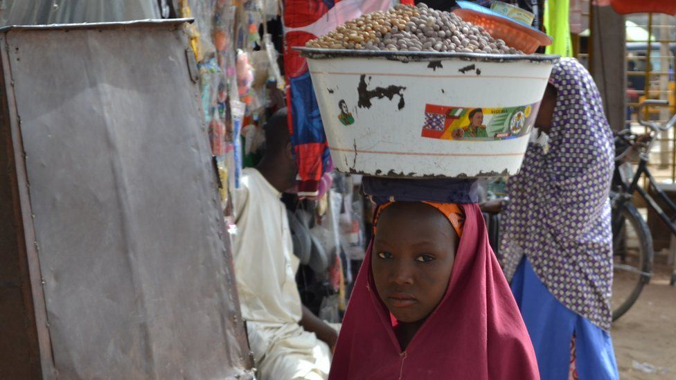 A girl selling food in Kano, Nigeria