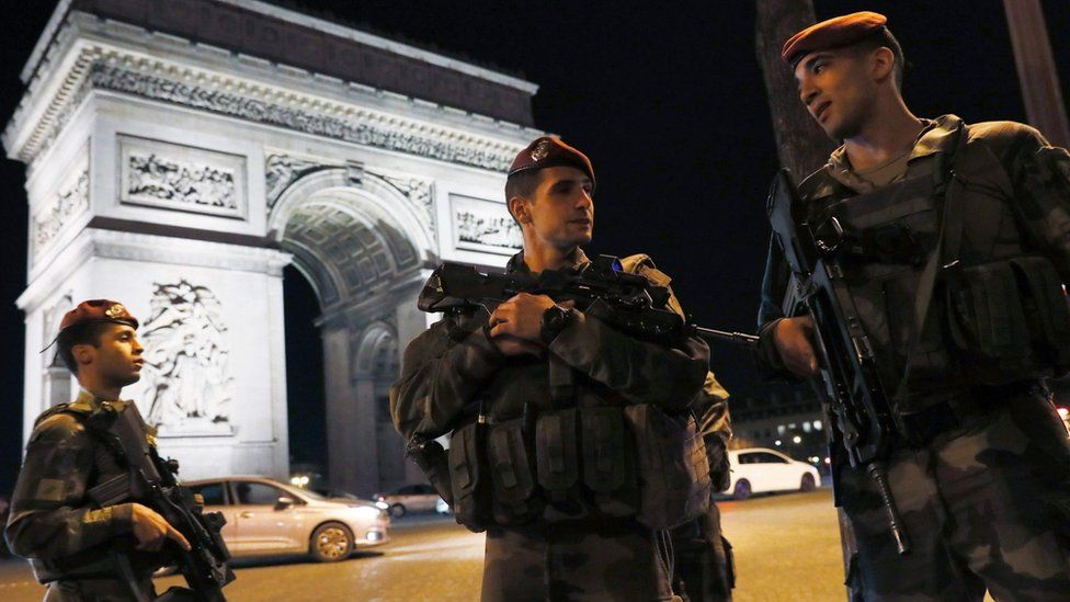 French soldiers stand guard at the Arc de Triomphe near the Champs Elysees in Paris after a shooting on April 20, 2017.