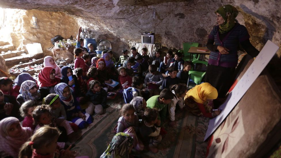 children going to school in a cave in Syria