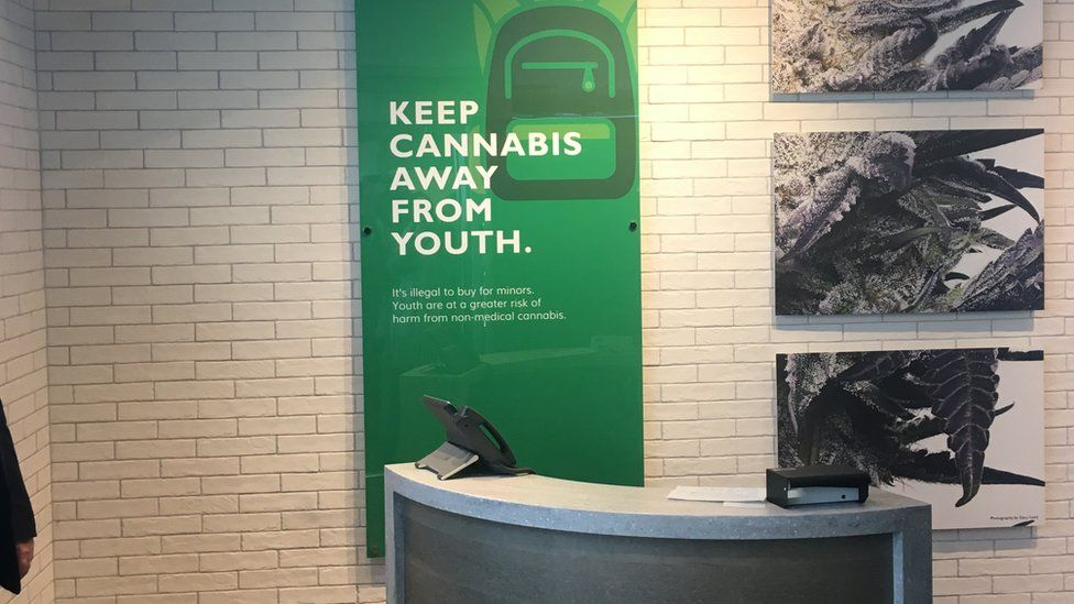 A sign at a cannabis store in British Columbia warns to keep the product away from children