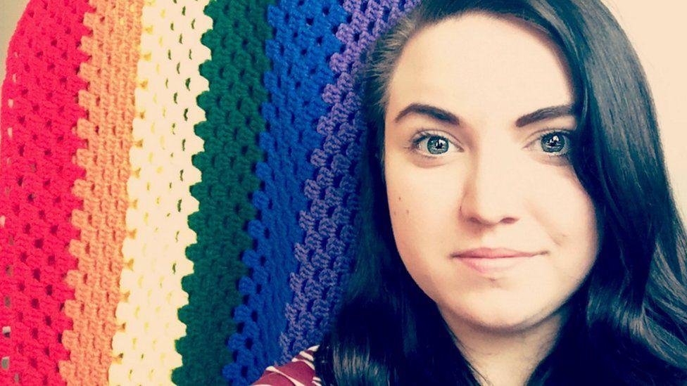 Rachel Hobbs Denton and her rainbow quilt
