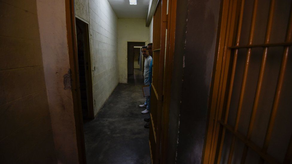 Inmates are seen in a sector of the El Rodeo prison where a new penitentiary system is being implemented and prisoners with good conduct receive military training, in Guatire, 20km from Caracas, on July 1, 2016.