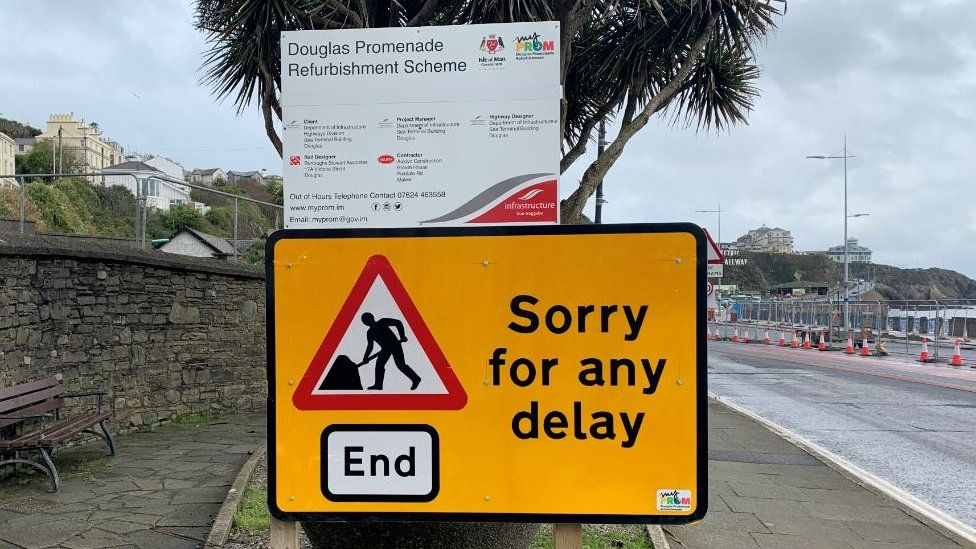 """DOI road works sign apologising for """"any delay"""""""