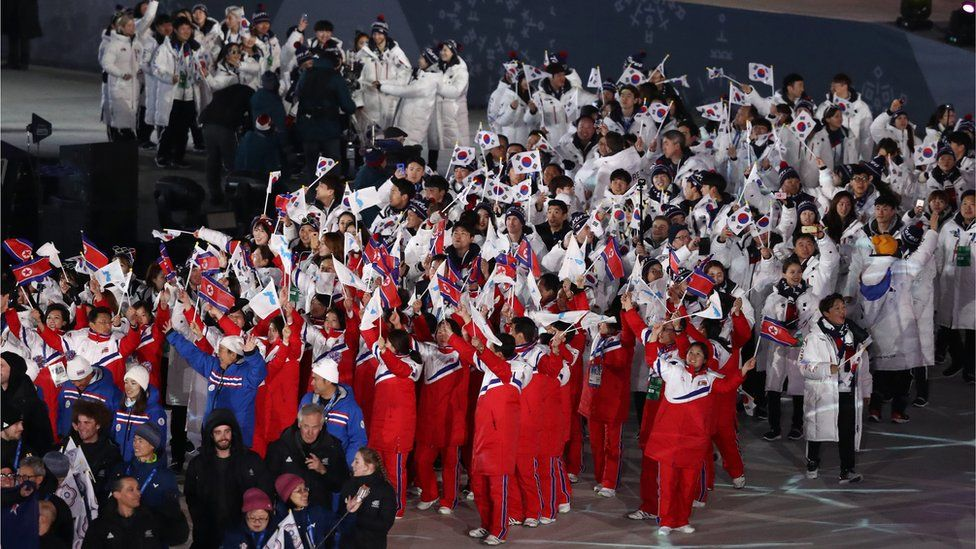 Team North Korea and Team South Korea walk together in the Parade of Athletes during the Closing Ceremony of the PyeongChang 2018 Winter Olympic Games at PyeongChang Olympic Stadium on February 25, 2018 in Pyeongchang-gun, South Korea