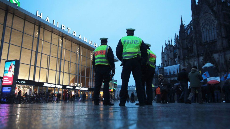 Police stand guard outside Cologne Station (11 Jan)