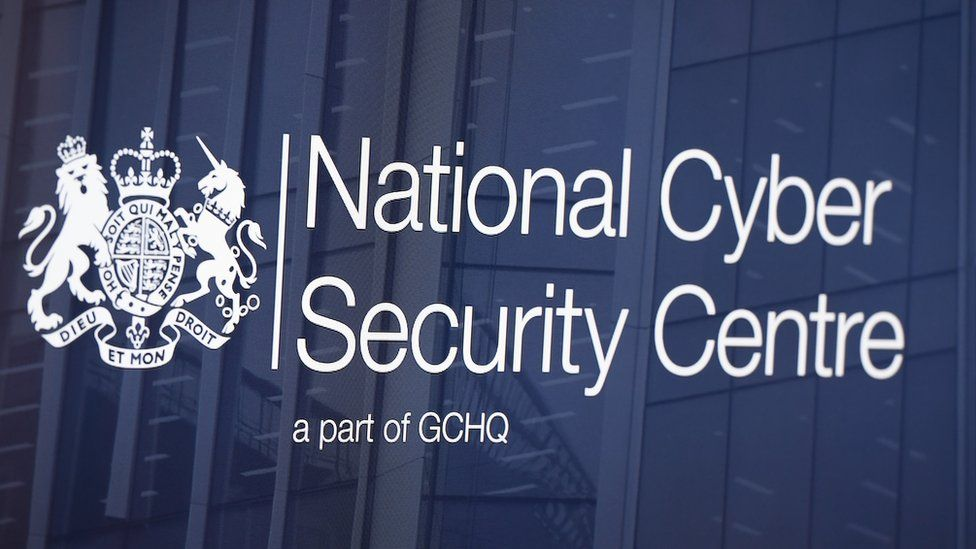 the NCSC logo is seen on a glass pane of a building