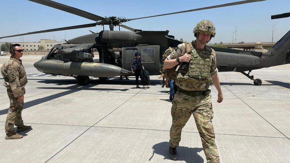 Brigadier Richard Bell gets off a helicopter in Iraq