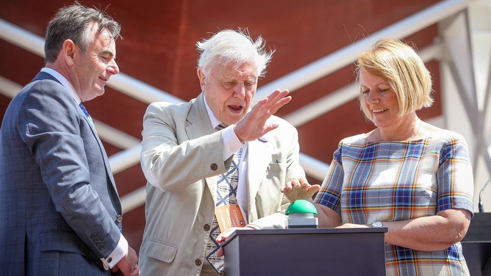 Sir David Attenborough presses button