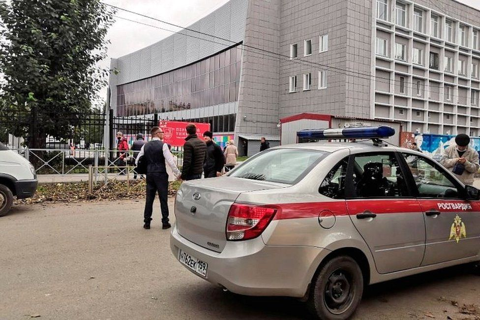 A car of Russia's National Guard is seen at the scene after a gunman opened fire at the Perm State University in Perm, Russia, on 20 September 2021