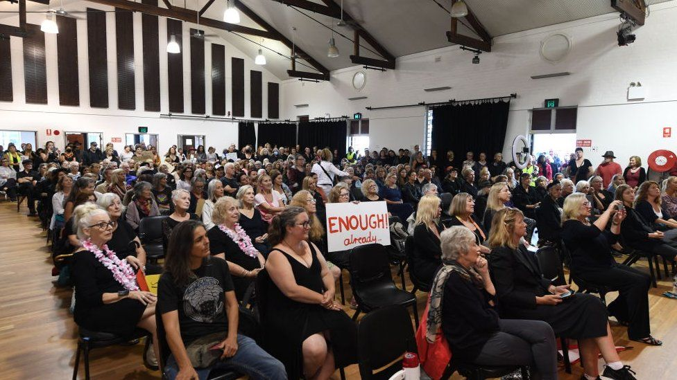 Locals gather into a hall in Mullumbimby for a March 4 Justice protest
