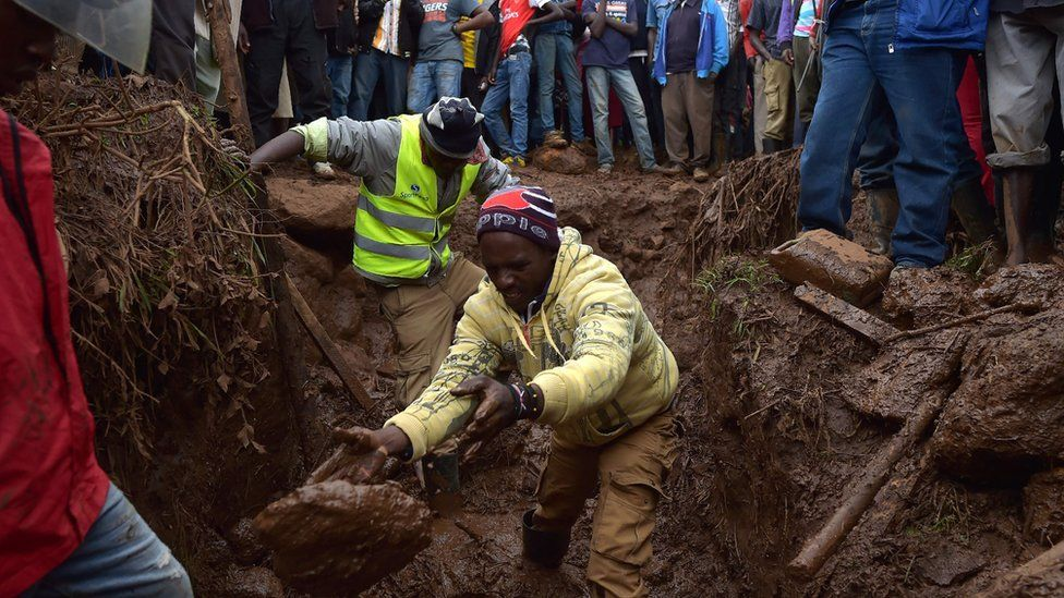 Villagers dig through mud as they attempt to find survivors of flash flooding at Solai in Subukia, Nakuru County on May 10, 2018,