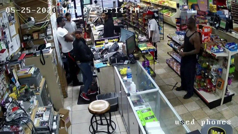 George Floyd is seen in security camera footage in a grocery store