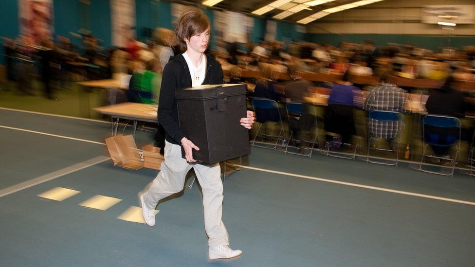 Teen runs with ballot boxes