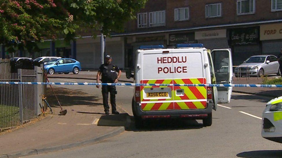 A police cordon near shops in Llanrumney