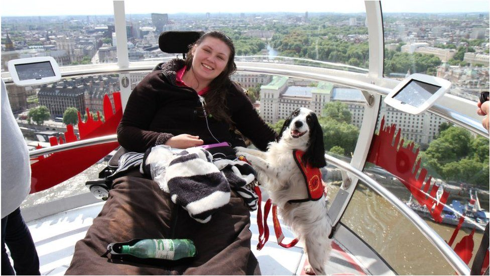 Lucy Watts on the London Eye with her support dog Molly