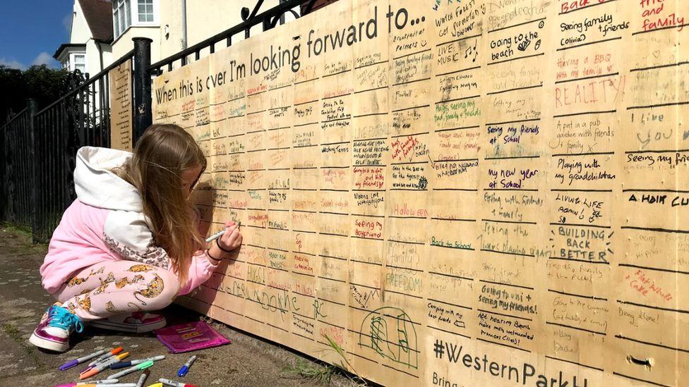 Young girl writes on wall