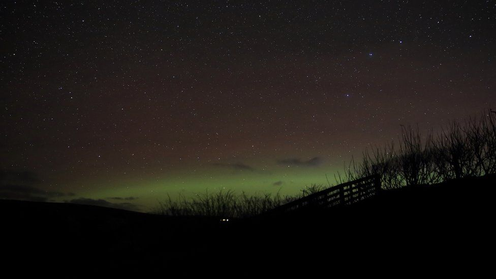 Northern lights low in the sky