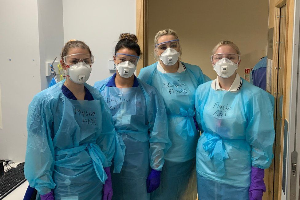 Molly, second from left, with other physios, before she got ill