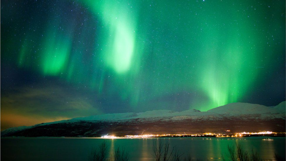 The northern lights reflected in the sea
