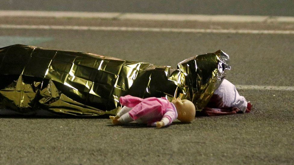 A body is seen on the ground July 15, 2016 after a truck ran into a crowd celebrating the Bastille Day national holiday July 14.