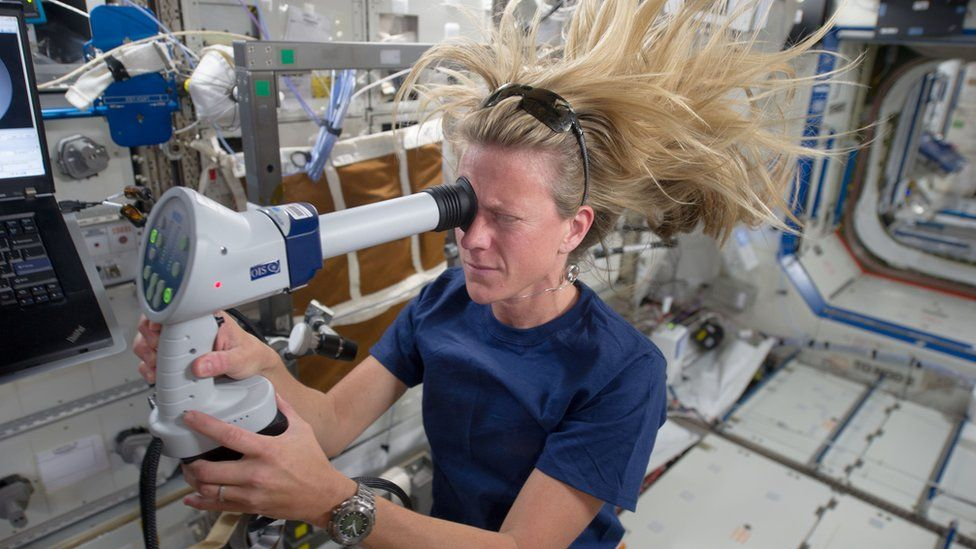 Astronaut Karen Nyberg taking an eye exam