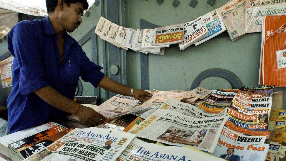 Indian newspaper vendor arranges morning editions