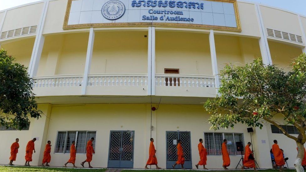 Buddhist monks arrive at the court building to attend the verdict of former Khmer Rouge leaders Khieu and 'Brother Number 2' Nuon Chea at the Extraordinary Chambers in the Courts of Cambodia (ECCC) in Phnom Penh on November 16, 2018