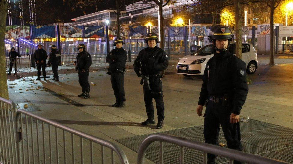 Police officers secure the Stade de France stadium during the international friendly football game France against Germany